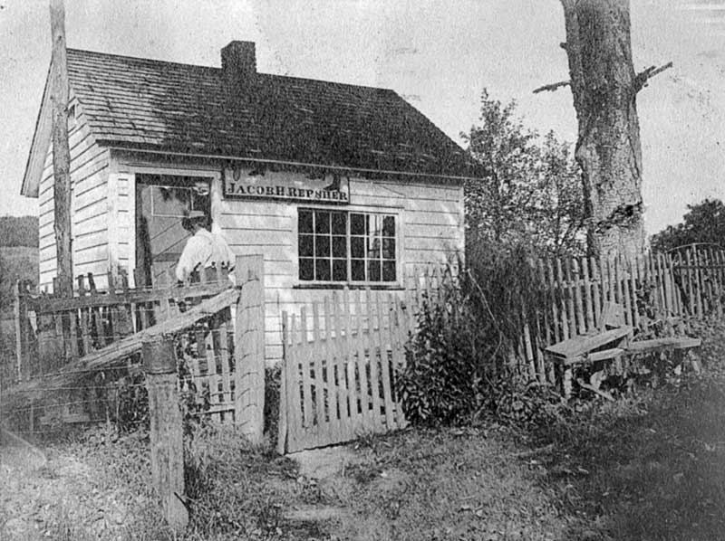 Jacob H. Repsher's shoemaker shop in Bartonsville, circa 1904.