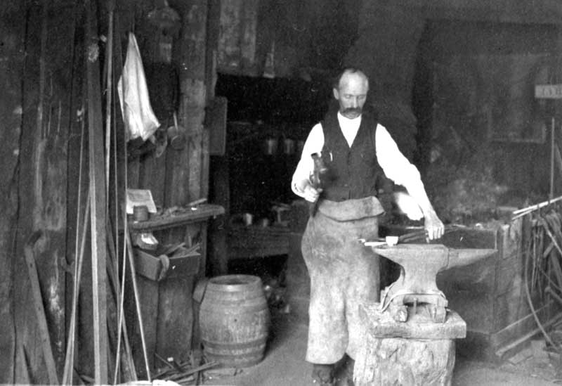 A local blacksmith at work in 1918.