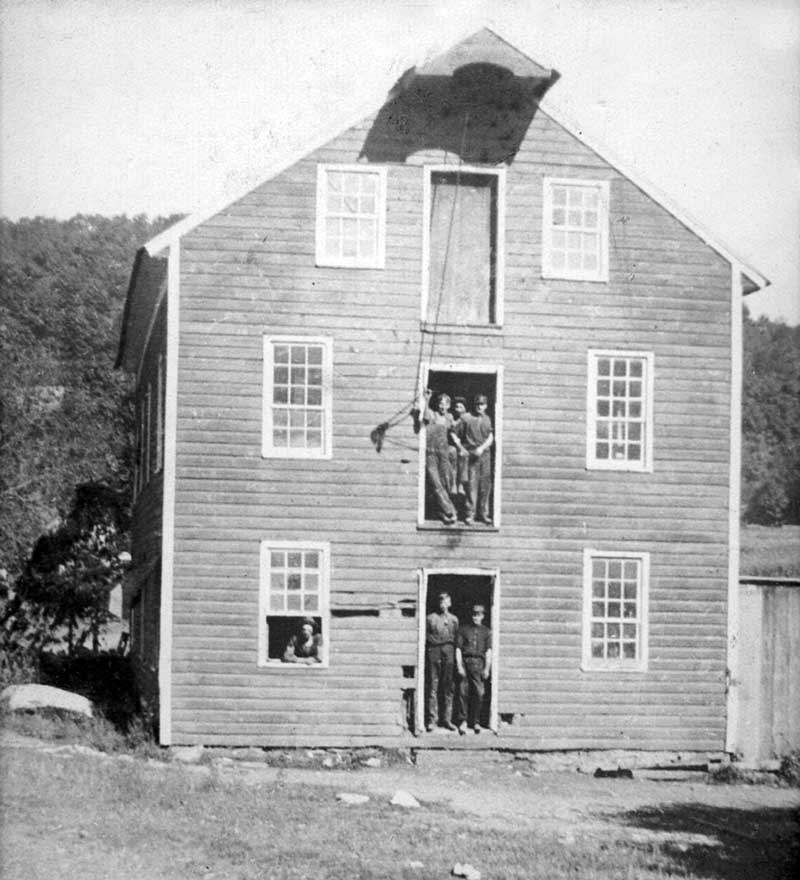 Glass or spectacles factory in Cherry Valley. Rollo LaBar is standing on the right in the doorway.