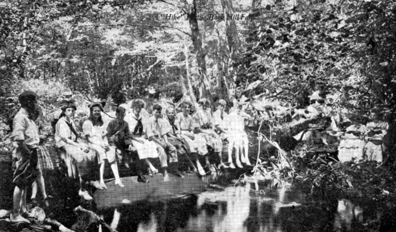Young people cool off by the river, circa 1912.