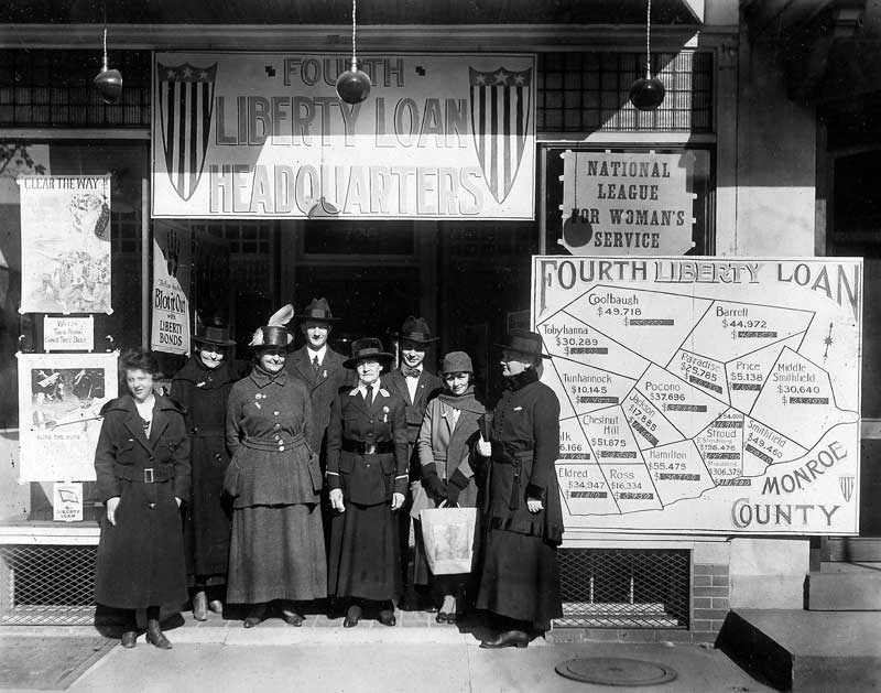 The Monroe County chapter of the National League for Women's Service spearheaded a drive to sell liberty bonds during World War I. From left: Mrs. Edith Brown, Mrs. Sally Booth, unknown, Rev. Emmons, Mrs. C.B. Staples, Harry Albert, Louise Congdon, and Mrs. Gilbert.