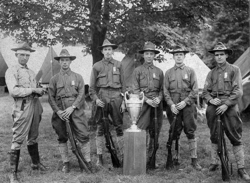 Soldiers celebrate winning a shooting tropy. Earl Kresge is third from right.