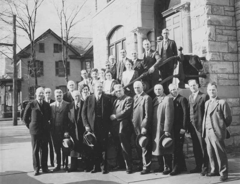 Staff in front of the Monroe County Courthouse, Jan. 4, 1932.